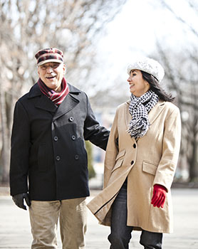 Man and woman walking in winter.