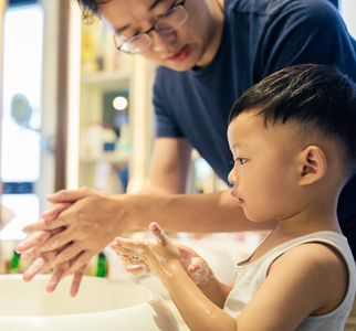 Dad and toddler washing hands