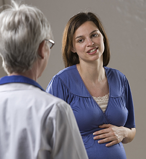 Pregnant woman talking to healthcare provider.
