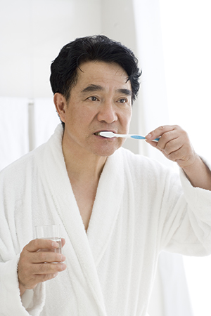 Man brushing his teeth.